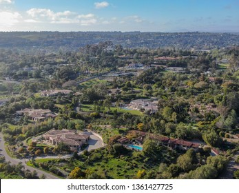 Aerial view of wealthy countryside area with luxury villas with swimming pool, surrounded by forest and mountain valley. Ranch Santa Fe. San Diego, California, USA.  03/19/2019