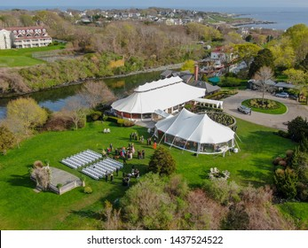 Aerial view of wedding reception ceremony setup with big white tents next the seas in Castle Hill Inn, Newport, Rhode Island, USA. 05/13/2019