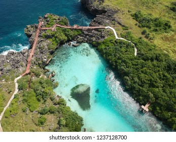 Aerial view of Weekuri Lagoon with long wooden bridge in Sumba island, East Nusa Tenggara Indonesia