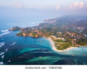 Aerial view of the Weligama cape with fishing village at sunrise. Sri Lanka