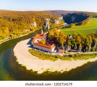 Aerial view to Weltenburg Abbey - Kloster Weltenburg. This landmark is a Benedictine monastery in Weltenburg in Kelheim on the Danube in Bavaria, Germany.