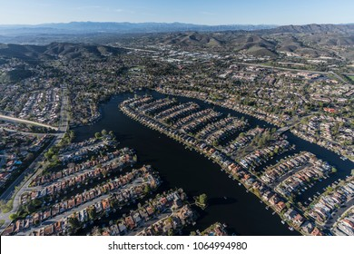 Aerial view of Westlake Island and lake in Thousand Oaks and Westlake Village neighborhoods in Southern California.
