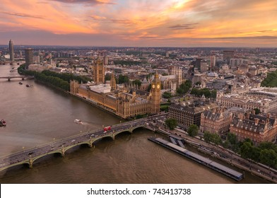 Aerial view of Westminster Bridge and Houses of parliament with a stunning sunset in the background. London, England