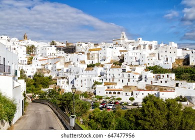 Aerial view of white city in sunny day (pueblo blanco) Vejer de la Frontera in Andalusia. White villages are popular tourist destinations and attraction in Spain, Malaga province, Europe.