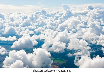 Aerial view, white clouds above the land