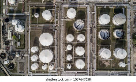 Aerial view white fuel storage tank in oil refinery plant, Top view white Industrial tanks for petrol and oil.