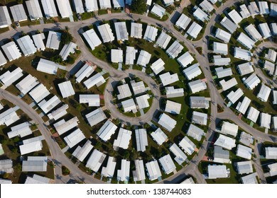 Aerial view of white roofed homes and streets forming circular patterns; St. Petersburg, Florida, USA