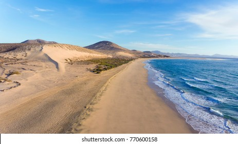 Aerial view of white sand beach, dunes, mountain panorama, Jandia, Costa Calma, Fuerteventura, Canary Islands .