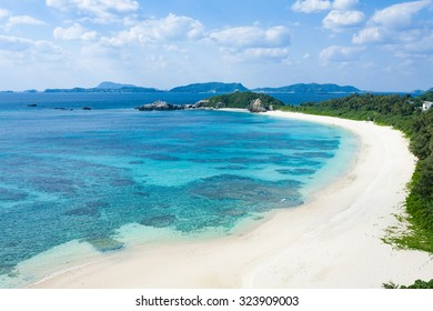 Aerial view of white sand tropical beach with clear blue water, Tokashiki Island of Kerama Islands National Park, Okinawa, Japan