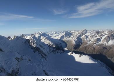 Aerial view of white snow mountain, southern alps, NZ, South island, Canterbury region, UNESCO world heritage sites, popular tourist destination, hiking,