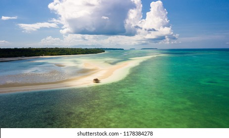 Aerial view of the wide Ohoidertawun white sand beach at low tide, Kei Cecil island, Indonesia