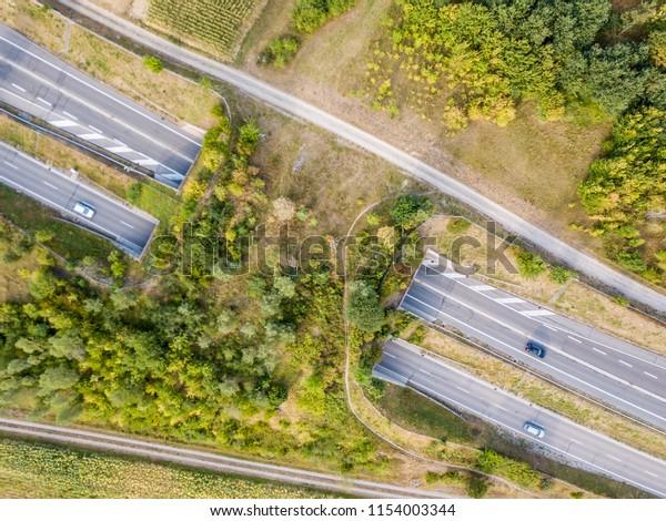 Aerial view of wildlife overpass over highway in Switzerland dur