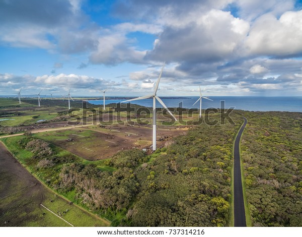 Aerial view of wind farm, ocean and agricultural fields in Australia