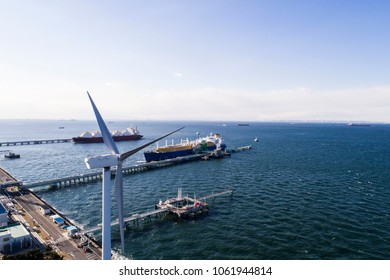 Aerial view of wind power generator and harbor.