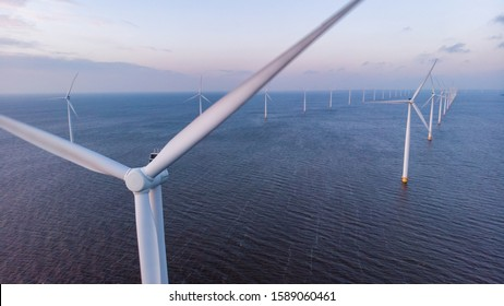 Aerial view of wind turbines at sea, North Holland, Netherlands, Beautiful sunset above the windmills