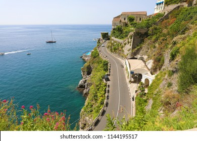 Aerial view winding street overhanging the sea from Atrani to Amalfi on Amalfi Coast, Italy