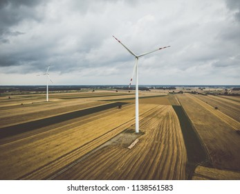 Aerial view of windmill against cloudy sky