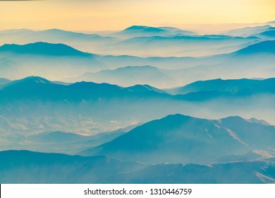 Aerial view from window plane of chilean andes mountains
