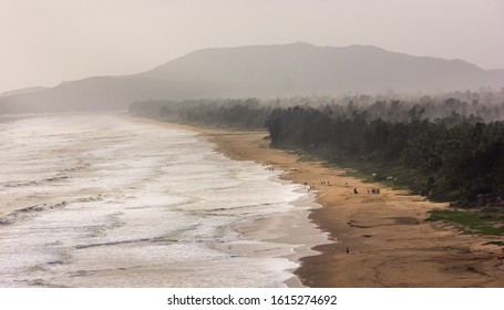 Aerial view of the windswept, misty landscape of the sea and the beach in the town of Gokarna in Karnataka, India.