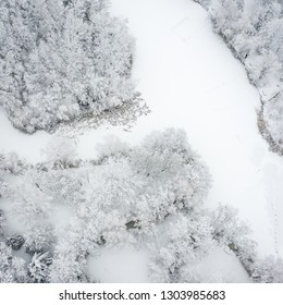Aerial view of winter beautiful landscape with trees covered with hoarfrost and snow. Winter scenery from above. Landscape photo captured with drone.