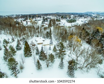 aerial view in winter overlooking small community of homes
