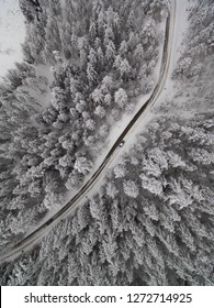 Aerial view of winter road in snowy forest. Drone captured shot from above. Mountain Goc, near city Kraljevo and Vrnjacka Banja, Serbia