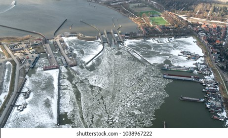 Aerial view in the winter of the sluice ORANJESLUIS at Amsterdam Schellingwoude, Holland. Lots of ice and snow at river IJ.
