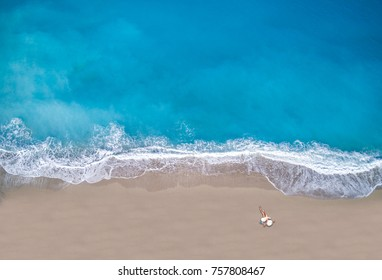 Aerial view of a Woman at the beach in Greece