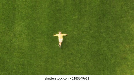Aerial view of a woman lying in a grass