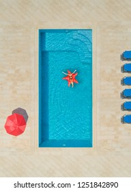 Aerial view of woman on star shapes inflatable mattress in swimming pool surrounded by deck chairs and parasol.