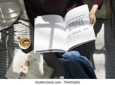 Aerial view of woman reading a book