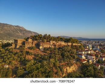 Aerial view of the wonderful old town of Kalamata City and the historical Castle at Sunset. Kalamata has become a top tourist attraction located in Messinia, Peloponnese, Greece.