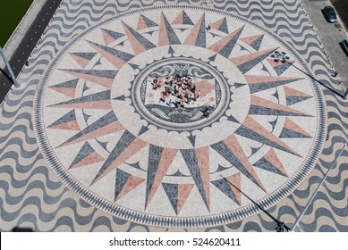 Aerial view of the world map mosaic with people standing in the middle, Lisbon, Portugal