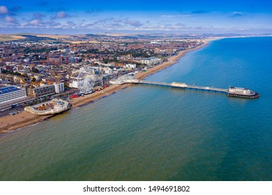 Aerial view of Worthing, England showing Worthing Pier, Ferris Wheel and beach
