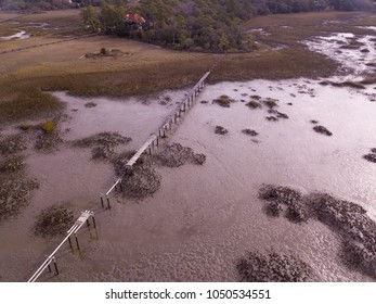 Aerial view of wrecked dock over low tide mud in South Carolina.