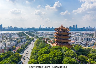 """Aerial view of  Wuhan city .Panoramic skyline and buildings beside yangtze river.4 Chinese letters on tower is """"Nang Xiong Gao Gong"""" means """"amazing heaven"""""""