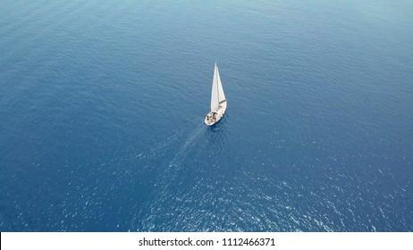 aerial view. the yacht goes in the open sea under sail