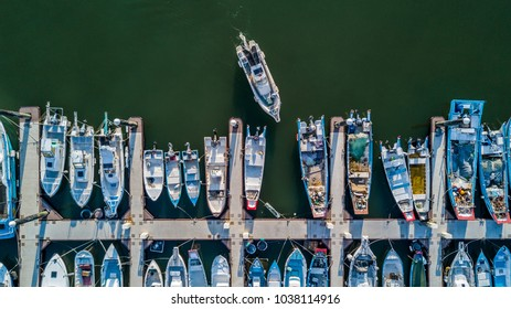 Aerial view Yacht parking, A marina lot, Yacht and sailboat is moored at the quay, Aerial view by drone.