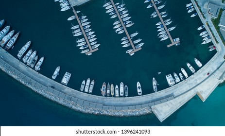 Aerial view of yachts and boat berthed in the marina and clear water. Aerial view of the Marina in Turkey. Holiday icons .