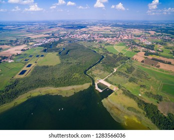 Aerial view of yachts sailing on Mamry Lake, concrete quay and town beach, Wegorzewo, Mazury, Poland