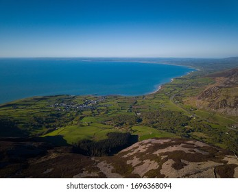 Aerial view of Yr Eifl Mountain with Irish Sea in the background