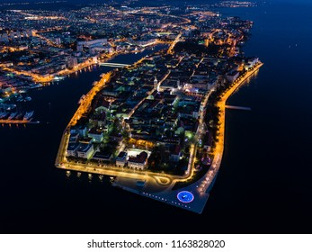 Aerial view of Zadar peninsula from air during night, street lights, Adriatic sea, Croatia