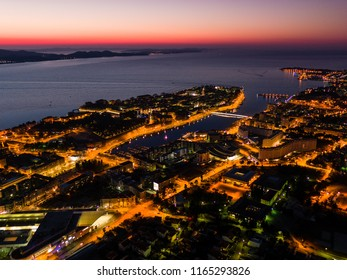 Aerial view of Zadar peninsula from air during sunset, street lights, Adriatic sea, Croatia