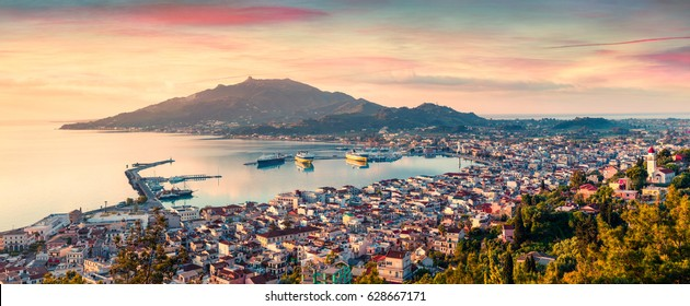 Aerial view of Zakynthos (Zante) town. Colorful spring sunrise on the Ionian Sea. Beautiful cityscape panorama of Greece city. Traveling concept background. Artistic style post processed photo.