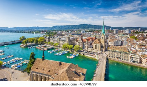 Aerial view of Zurich city center with famous Fraumunster Church and river Limmat at Lake Zurich from Grossmunster on a sunny day with blue sky and clouds in summer, Canton of Zurich, Switzerland