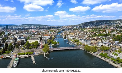 Aerial View of Zurich Cityscape in Switzerland with Beautiful Sky and Clouds feat. City Center Town Hall and Famous Landmarks