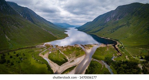aerial viewpoint of loch etive at the foot of glen etive near glen coe in the argyll region of the highlands of scotland near fort william in summer showing clear calm waters and tall green mountains