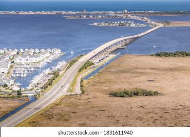 Aerial views of bridge crossing Manteo to Nags Head with marina