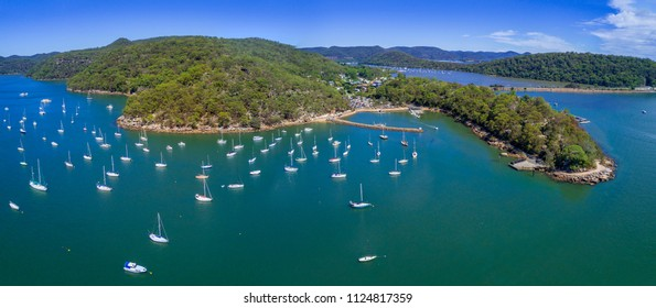 Aerial views of Brooklyn on the Hawkesbury River and its estuarine waterways and bays have many luxury yachts moored in its waters.