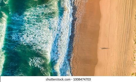 Aerial views drones beach shadow people sunrise